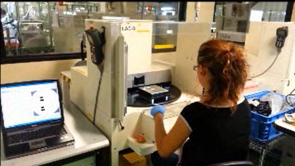 A woman is working on laser engraving at a MIRSA manufacturing facility.